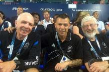 Photo: Royal photobomb! Prince Harry shows double thumbs up behind an unaware rugby coach from New Zealand during CWG, Glasgow