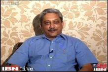 Goa CM Parrikar shares food plate with HIV-positive children