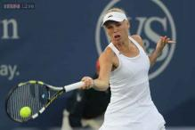 Caroline Wozniacki comes back for win at New Haven