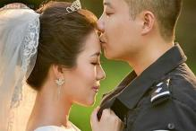 Photos: On-duty Chinese police officer too busy to leave work shoots incredible wedding album with his wife at the police station