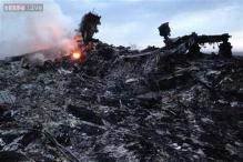 Experts comb MH17 crash site as Ukraine fighting rages