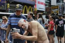 Political candidate strips naked at Times Square to campaign for the right to be nude in public