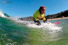 Watch: Quincy Symonds suffers from a rare genetic disease but that doesn't stop her from being the world's best six-year-old surfer!