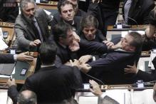 Punches were thrown and suits grabbed as a violent scuffle erupted in the Turkish parliament!