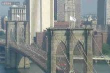 The mystery of white flags on Brooklyn Bridge has been solved! Two German artists claim responsibility for replacing the American flags with white flags