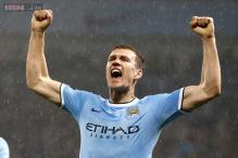 Edin Dzeko happy with his and Manchester City's prospects