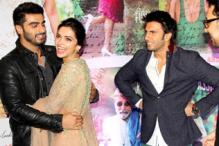 Arjun Kapoor gives Deepika Padukone a warm hug as Ranveer Singh looks on questioningly at the 'Finding Fanny' success bash