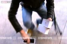 Oh no precioussssss......! World's first person to buy the iPhone 6 drops it immediately on the pavement on live TV because his hands were shaking