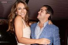 Indian origin married banker Julian Bharti, 27, pays $88,000 to kiss Elizabeth Hurley, says his wife 'is cool about it'