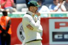 Michael Clarke guided by physio on injury comeback