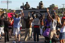 Ferguson video shows witness raising hands in air
