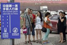 You'll never walk into a pole again: Chinese city creates a cellphone sidewalk lane for people who cannot walk without texting