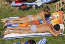 French women bid topless sunbathing 'adieu' as baring breasts is seen as 'vulgar'