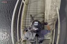 Photos: What a daring nope! GoPro captures man riding his bike like a boss on narrow ledge on top of a bridge