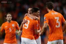 Dutch beat 10-man Kazakhstan with late goals in Euro Qualifiers