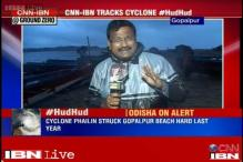 Cyclone Hudhud: Fishermen rush to protect their boats before they evacuate the Gopalpur beach