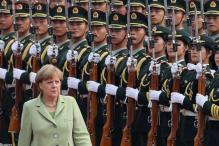 German Chancellor Merkel voices 'cautious optimism' for Russia-Ukraine gas deal