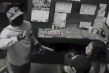 Masked gunman apologises and kisses couple before robbing more than $5,000 off them!