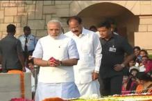 Modi pays tribute to Mahatma Gandhi at Rajghat on his 144th birth anniversary