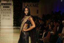 Snapshot: Supermodel Naomi Campbell turns heads in a black sari as she attends a launch event