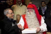 Photos: You'll love these images of Indian President Pranab Mukherjee getting a Christmas gift from Santa Claus at the Santa Claus Village in the Arctic Circle