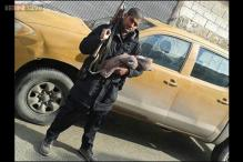 Indian-origin ISIS member poses with AK-47 and his newborn, posts a picture on Twitter