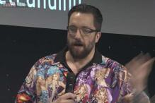 Scientist apologises for wearing shirt having a collage of pinup girls in various states of undress