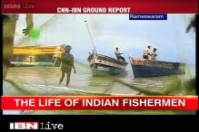 Unfazed by the danger, fishermen continue to sail in troubled waters