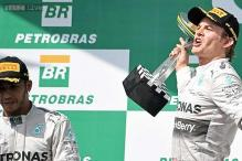 Nico Rosberg holds off Lewis Hamilton to win the Brazilian GP