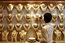 Gold prices decline to over 3-year low on global cues
