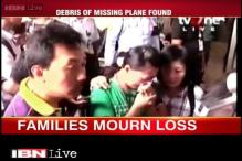 Family members of those aboard AirAsia Flight 8501 collapsed in agony