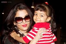 Getting used to the paparazzi? Aaradhya Bachchan smiles for the camera as she arrives in Mumbai with mum Aishwarya Rai