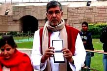 New Delhi: Kailash Satyarthi visits Rajghat to pay tribute to Mahatma Gandhi