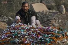 Burying the dead after Pakistan's school massacre
