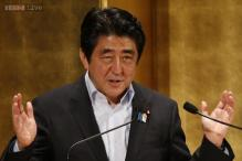 Shinzo Abe's coalition secures big Japan election win with record low turnout