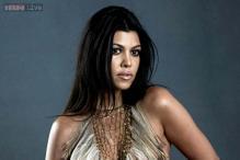 Pregnant Kourtney Kardashian poses nude for a magazine cover