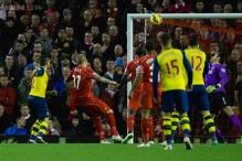 EPL: Liverpool score late for 2-2 draw against Arsenal
