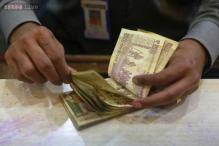 India agrees to cut stakes in state banks; could raise $1.6 trillion