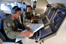 Search teams unclear whether oil, objects found in sea linked to lost AirAsia flight QZ 8501