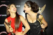 Sonam Kapoor poses with her 'date' Jacqueline Fernandez on the red carpet at the Colors Stardust Awards