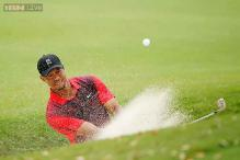 Tiger Woods's triple bogey leaves him tied for last