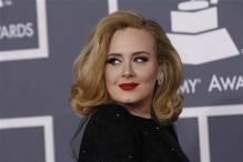 Adele flashes ring post split rumours