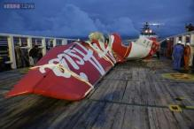 Divers find more bodies, reach AirAsia fuselage