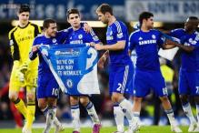 Chelsea into Capital One Cup final after fiery win over Liverpool