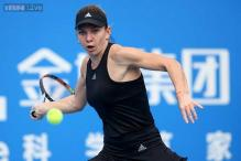 Halep, Zvonareva march on at Shenzhen Open