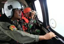 Indonesia widens search area in hunt for AirAsia QZ8501 jet