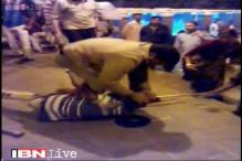 Caught on camera: RPF personnel brutally beats up a physically challenged beggar at Howrah station