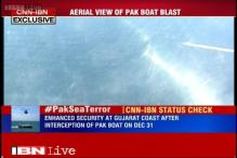 Analysing security from on-board a Dornier aircraft near Porbandar port