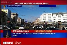 Paris gunman arrested, hostages freed