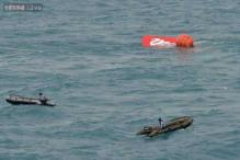Indonesian search team raises tail of crashed AirAsia plane, no black box found